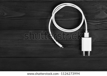 Cable phone chargers on wood background #1126273994