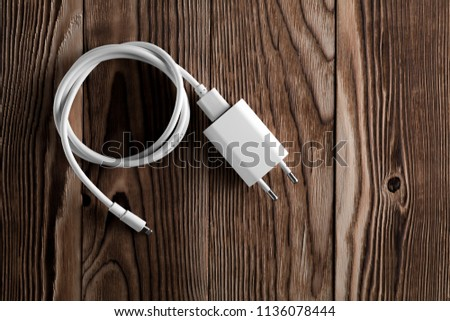 Cable phone chargers on wood background #1136078444