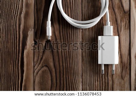 Cable phone chargers on wood background #1136078453