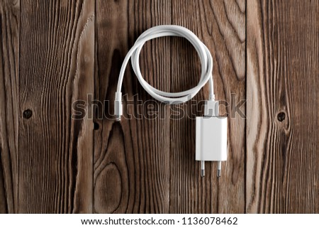 Cable phone chargers on wood background #1136078462