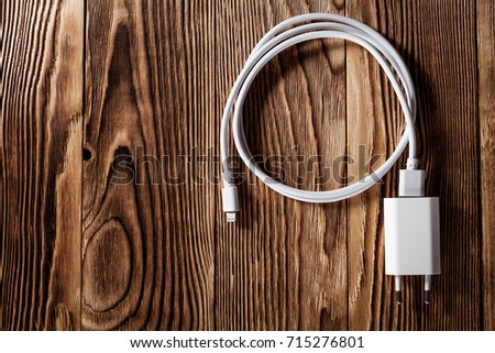 Cable phone chargers on wood background #715276801