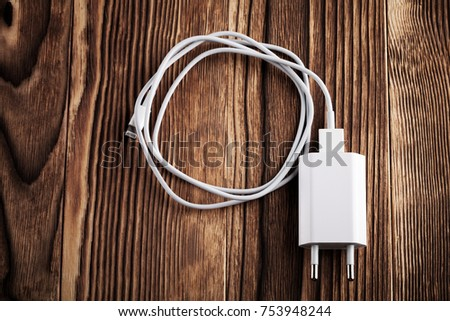 Cable phone chargers on wood background #753948244