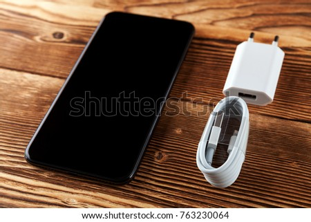 Cable phone chargers on wood background #763230064