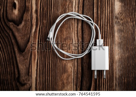Cable phone chargers on wood background #764541595