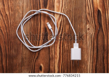 Cable phone chargers on wood background #776834215