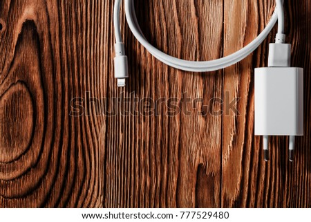 Cable phone chargers on wood background #777529480