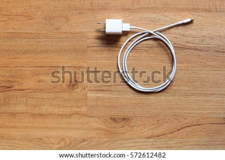 Cable phone chargers on wood background, Top view. #572612482