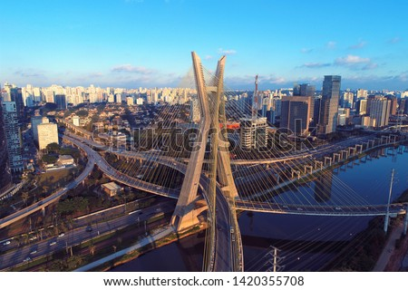 Cable-stayed bridge aerial view. São Paulo, Brazil. Business center. Financial Center. Great landscape. Estaiada`s bridge, Sao Paulo. Sunset scene. Transportation and downtown. City life aerial view.
