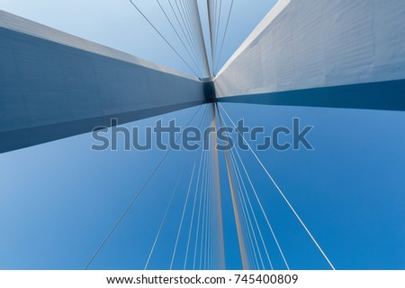 cable-stayed bridge closeup against a blue sky , abstract structure background
