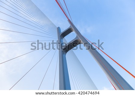 cable stayed bridge closeup against blue sky , upward view #420474694