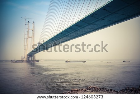 cable-stayed bridge construction in yangtze river - stock photo