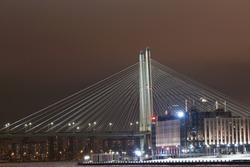 Cable-stayed bridge in the night. One of the pillars of the Bolshoi Obukhovsky (Vantovoy) Bridge in St. Petersburg at night near Obukhovsky Oborony Avenue.