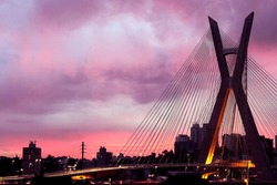 Cable stayed bridge on Sao Paulo state, Brazil. Pink sky, sunset. South America. Urban view in a cloud day. Metropolis.