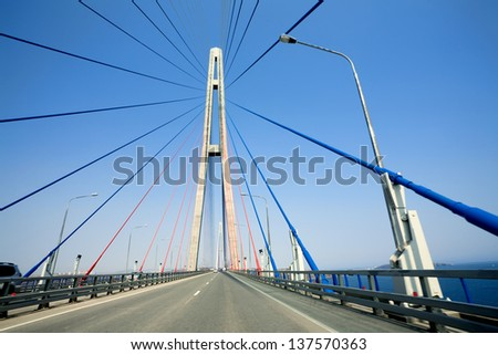 cable-stayed bridge to Russian Island. Vladivostok. Russia. Vladivostok is the largest port on Russia's Pacific coast and the center of APEC Forum 2012. #137570363