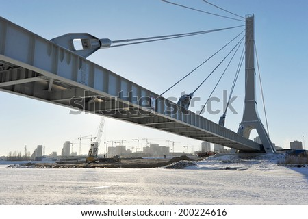 cable-stayed pipeline in St. Petersburg in winter #200224616