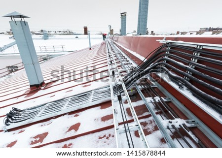Cable tray outside with telecommunications cables, ground cables, optic fiber, power cables and transmitter data cables from antennas and outdoor remote radio units to inside equipment of #1415878844
