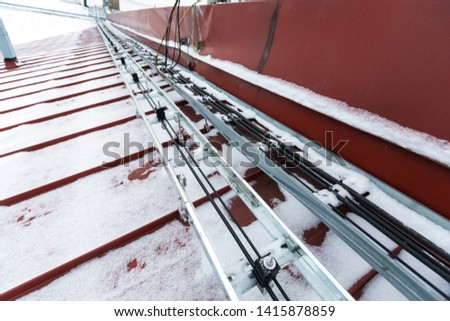 Cable tray outside with telecommunications cables, ground cables, optic fiber, power cables and transmitter data cables from antennas and outdoor remote radio units to inside equipment of #1415878859