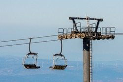 Cableway in mountains for skiers in ski resort