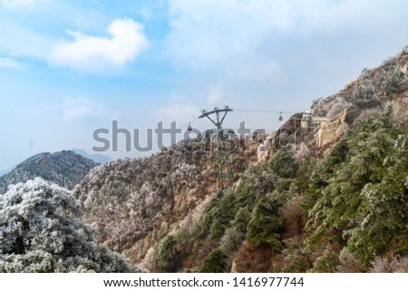 Cableway in the distance from the mountain #1416977744