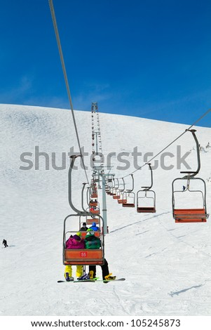 Cableway in the mountains with skiers