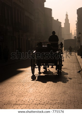 Cabman driving the tourists in a carriage in the morning