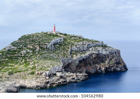 Cabrera island. Old lighthouse on the rock cape.