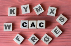 CAC (Customer Acquisition Cost) - acronym on wooden cubes on a pink wooden background.