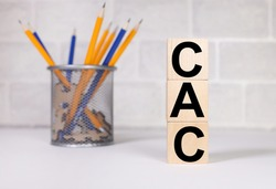 CAC. Customer Acquisition Cost, text on wood cubes. text in black letters on wood blocks