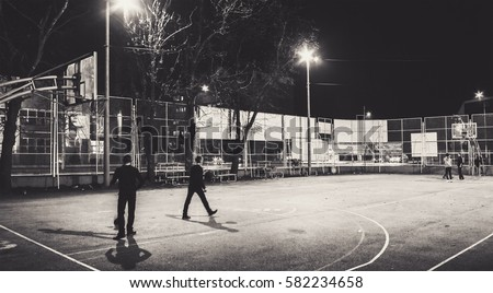 Cacak town in Serbia, cinematic view of the basketball court during night. #582234658