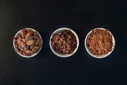 Cacao beans seeds, Cacao nibs and cacao powder isolated on black background.