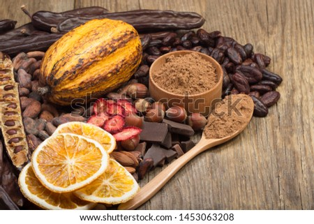 cacao pods, carob pods and dried fruits on wooden background #1453063208