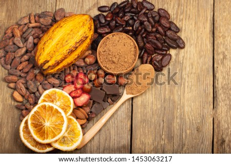 cacao pods, carob pods and dried fruits on wooden background #1453063217