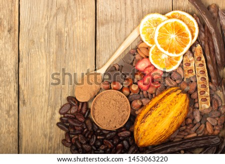 cacao pods, carob pods and dried fruits on wooden background #1453063220