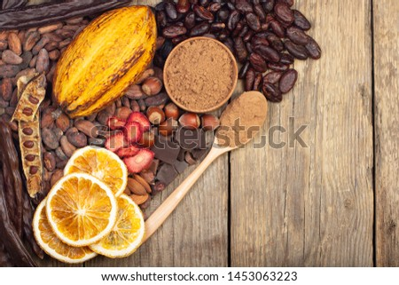 cacao pods, carob pods and dried fruits on wooden background #1453063223