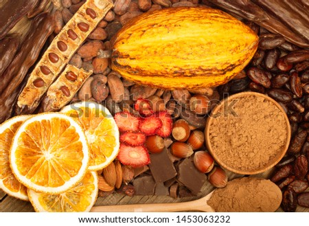 cacao pods, carob pods and dried fruits on wooden background #1453063232
