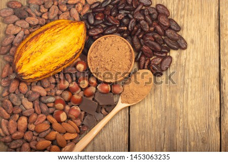 cacao pods, carob pods and dried fruits on wooden background #1453063235