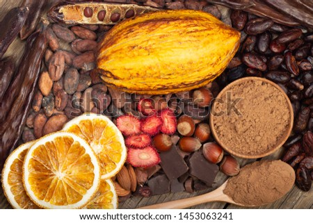 cacao pods, carob pods and dried fruits on wooden background #1453063241
