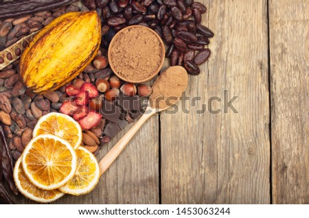 cacao pods, carob pods and dried fruits on wooden background #1453063244