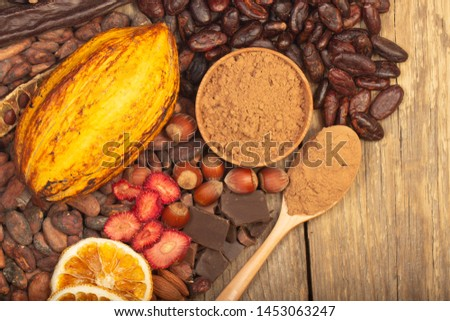 cacao pods, carob pods and dried fruits on wooden background #1453063247
