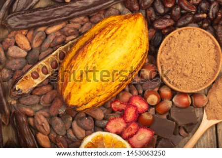 cacao pods, carob pods and dried fruits on wooden background #1453063250