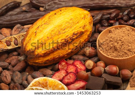 cacao pods, carob pods and dried fruits on wooden background #1453063253
