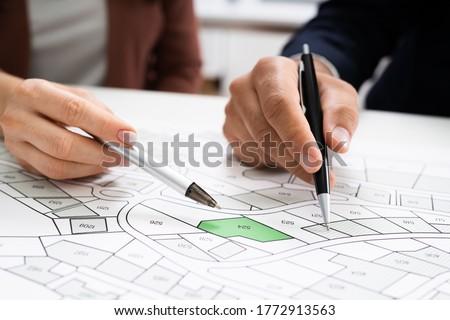 Cadastre Land Map. Cartographer Locating Building Plot Сток-фото ©