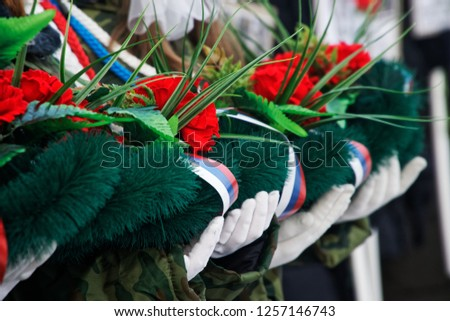 Cadets hold a wreath and flowers in memory of those killed in wars and armed conflicts. The memory of the victims of the war. Russia