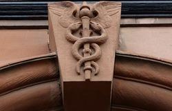 Caduceus carving on keystone