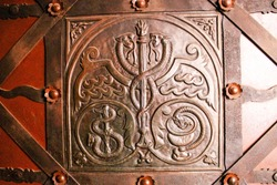 Caduceus, Rod of Asclepius and Bowl of Hygieia incused on the door of Medieval pharmacy