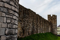 Caernarfon castle, Wales. City walls. Imposing, historic medieval defensive structure. Landscape view - copy space.