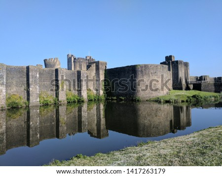 Caerphilly castle reflection in moat