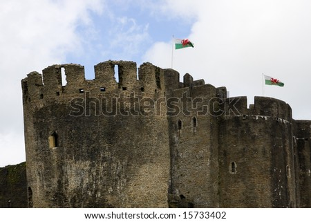 Caerphilly castle towers with Welsh flags, South Wales, UK