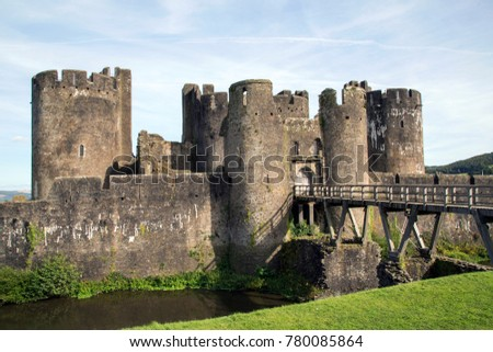 Caerphilly Castle was constructed by Gilbert de Clare in the 13th century as part of his campaign to conquer Glamorgan, it is the second largest castle in Britain. Rear entrance with bridge and moat.