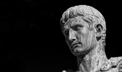 Caesar Augustus, first emperor of Ancient Rome. Old bronze statue in the Imperial Forum (Black and White with copy space)